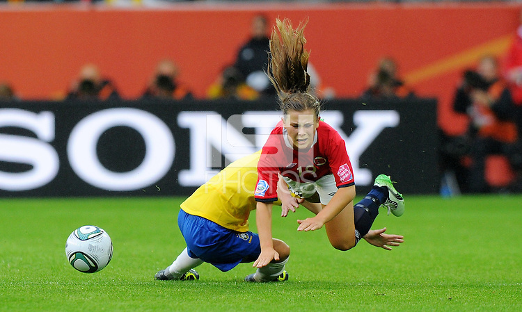 Daiane (l) of team Brazil and Emilie Haavi of team Norway during the FIFA Women's World Cup at the FIFA Stadium in Wolfsburg, Germany on July 3rd, 2011.