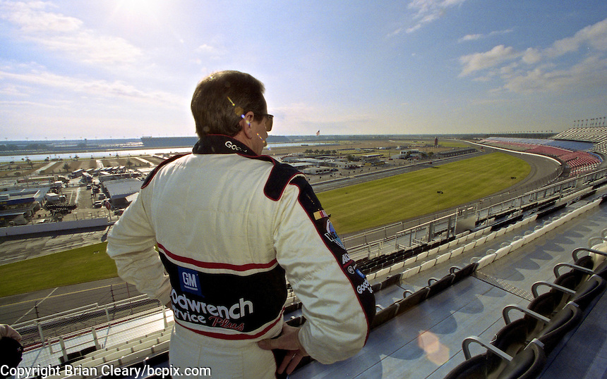 Dale Earnhardt looks out over Daytona International Speedway from the freshly opened Earnhardt Grandstand a few weeks before his death.  Daytona Beach, FL, January 2001.  (Photo by Brian Cleary/www.bcpix.com)