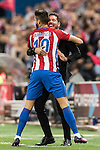 Coach Diego Simeone of Atletico de Madrid celebrates with Yannick Ferreira Carrasco of Atletico de Madrid during their La Liga match between Atletico de Madrid and Granada CF at the Vicente Calderon Stadium on 15 October 2016 in Madrid, Spain. Photo by Diego Gonzalez Souto / Power Sport Images
