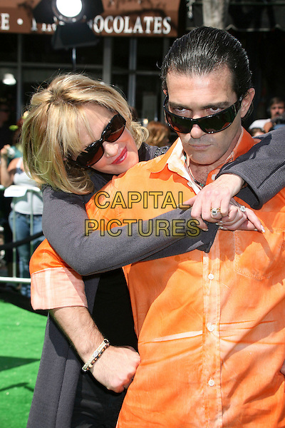 "MELANIE GRIFFITH & ANTONIO BANDERAS.Attending ""Shrek the Third"" Los Angeles Premiere at Mann's Village Theatre, Westwood, California, USA, .6 May 2007 .half length black sunglasses orange shirt married couple husband and wife.CAP/ADM/BP.©Byron Purvis/AdMedia/Capital Pictures."