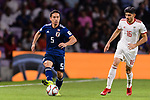 Nagatomo Yuto of Japan (L) fights for the ball with Mahdi Torabi of Iran (R) during the AFC Asian Cup UAE 2019 Semi Finals match between I.R. Iran (IRN) and Japan (JPN) at Hazza Bin Zayed Stadium  on 28 January 2019 in Al Alin, United Arab Emirates. Photo by Marcio Rodrigo Machado / Power Sport Images