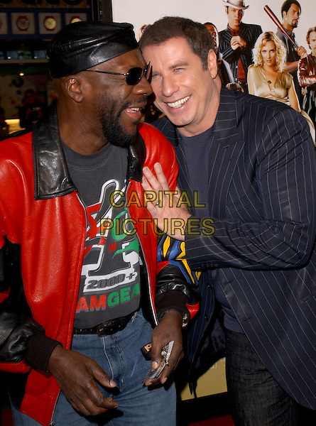 "ISAAC HAYES & JOHN TRAVOLTA.Attends MGM's World Premiere of ""Be Cool"" held at The Grauman's Chinese Theatre in Hollywood, California, USA, February 14th 2005.half length.Ref: DVS.www.capitalpictures.com.sales@capitalpictures.com.©Capital Pictures."