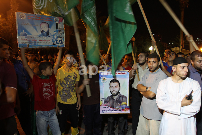 Palestinian members of Hamas celebrate a deal that will see Palestinian detainees freed in exchange for captured Israeli soldier Gilad Shalit on October 11, 2011, in Gaza City. Shalit was captured in 2006 by Hamas-allied militants in the Gaza Strip. Photo by Mohammed Asad