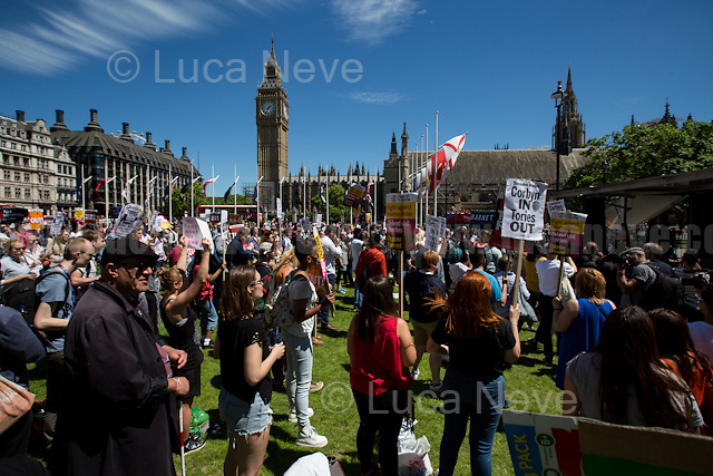 London, 10/06/2017. Today, hundreds of people held a demonstration in Parliament Square to protest against the election of Theresa May who will lead the next British Government supposedly in coalition with the Democratic Unionist Party (DUP - http://bit.ly/2s93eHf), the largest unionist political party in Northern Ireland led by Arlene Foster. At the end of the rally, some of the protesters marched to Downing Street.<br /> After 5 years of the Coalition Government (Conservatives &amp; Liberal Democrats) led by the Conservative Party leader David Cameron, and one year of David Cameron's Government (Who resigned after the Brexit victory at the EU Referendum held in 2016), British people voted in the following way: the Conservative Party gained 318 seats (42.4% - 13,667,213 votes &ndash; 12 seats less than 2015), Labour Party 262 seats (40,0% - 12,874,985 votes &ndash; 30 seats more then 2015); Scottish National Party, SNP 35 seats (3,0% - 977,569 votes &ndash; 21 seats less than 2015); Liberal Democrats 12 seats (7,4% - 2,371,772 votes &ndash; 4 seats more than 2015); Democratic Unionist Party 10 seats (0,9% - 292,316 votes &ndash; 2 seats more than 2015); Sinn Fein 7 seats (0,8% - 238,915 votes &ndash; 3 seats more than 2015); Plaid Cymru 4 seats (0,5% - 164,466 votes &ndash; 1 seat more than 2015); Green Party 1 seat (1,6% - 525,371votes &ndash; Same seat of 2015); UKIP 0 seat (1.8% - 593,852 votes); others 1 seat. <br /> The definitive turn out of the election was 68.7%, 2% higher than the 2015.<br /> <br /> For more info about the election result click here: http://bbc.in/2qVyNRd &amp; http://bit.ly/2s9ob51<br /> <br /> For my reportage about the &quot;Loyal Orange Lodge Annual Parade&quot; click here: http://bit.ly/2t7duNv