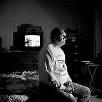 Tom Hanley in his apartment in Bayonne, New Jersey. His father was killed on the docks by the Mafia when he was just four months old. When he was 14 he played a part alongside Marlon Brando in On the Waterfront. He has been working on the docks for 50 years and is now Recording Secretary for dokers union Local 1588. The docks of New York and New Jersey have for generations been synonymous with organised crime, with the Genovese family in control of the New Jersey waterfront and the Gambinos in control of the New York side.