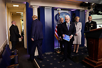 United States President Donald J. Trump with US Vice President Mike Pence leave after a press briefing on the Coronavirus COVID-19 pandemic with members of the Coronavirus Task Force at the White House in Washington on March 19, 2020. Looking on from behind are Stephen Hahn, Commissioner, US Food and Drug Administration (FDA); Dr. Deborah L. Birx, White House Coronavirus Response Coordinator; and US Surgeon General Vice Admiral (VADM) Jerome M. Adams, M.D., M.P.H.<br /> Credit: Yuri Gripas / Pool via CNP/AdMedia