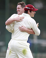Craig Gourlay (facing) of Highgate is congratulated after capturing a South Hampstead wicket during the Middlesex County Cricket League Division Three game between Highgate and South Hampstead at Park Road, Crouch End on Sat Aug 2, 2014
