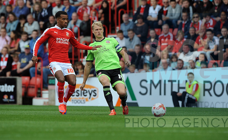 James McEveley of Sheffield United is challenged by Nathan Byrne of Swindon Town<br /> - English League One - Swindon Town vs Sheffield Utd - County Ground Stadium - Swindon - England - 29th August 2015
