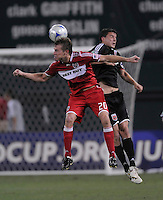 Chicago Fire forward Brian McBride (20) heads the ball against DC United defender Marc Burch (4) .  DC United defeated the Chicago Fire 2-1  at  RFK Stadium, Saturday June 13, 2009.