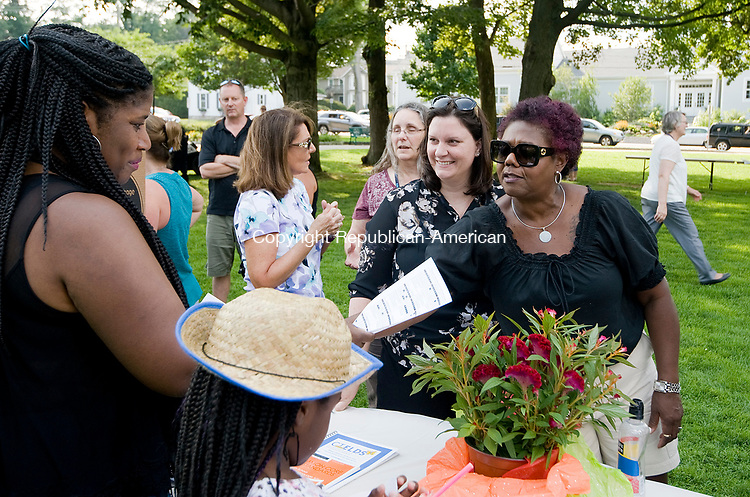 TORRINGTON, CT-081017JS04- Robin Love of Torrington and her daughter Kayla Love, 8, left,  talks with Torrington School Superintendent Denise Clemons, right, and Jennifer Brown, Executive Assistant to the Superintendent, second from right, during a back to school gathering Thursday at Coe Park in Torrington.  <br /> Jim Shannon Republican-American