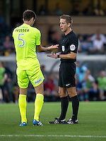 Referee John Brooks brandishes another yellow card, this time to Luke Prosser of Colchester United during the Sky Bet League 2 match between Wycombe Wanderers and Colchester United at Adams Park, High Wycombe, England on 27 August 2016. Photo by Liam McAvoy.