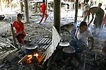 Cyclone Nargis survivors cock at a temple turned into a makeshift refugee center at the village of Kamingo in Irrawaddy Division, May 10, 2008. Despairing survivors in Myanmar awaited emergency relief on Friday, a week after 100,000 people were feared killed as the cyclone roared across the farms and villages of the low-lying Irrawaddy delta region. The storm is the most devastating one to hit Asia since 1991, when 143,000 people were killed in neighboring Bangladesh. Photo by Eyal Warshavsky  *** Local Caption *** ëì äæëåéåú ùîåøåú ìàéì åøùáñ÷é àéï ìòùåú áúîåðåú ùéîåù ììà àéùåø