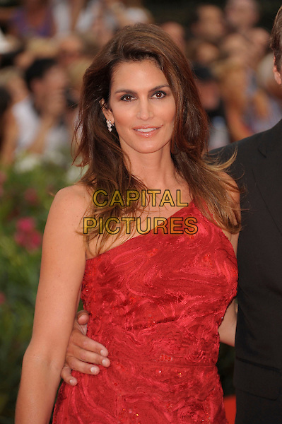 Cindy Crawford (wearing Roberto Cavalli).'The Ides of March' screening.68th Venice International Film Festival, Italy 31st August 2011.half length red one shoulder sequined sequins embroidered dress.CAP/PL.©Phil Loftus/Capital Pictures.