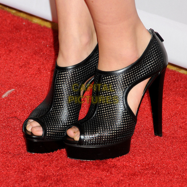 OLIVIA WILDE's shoes.EIF's Women's Cancer Research Fund Benefit held at the Beverly Wilshire Hotel, Beverly Hills, California, USA..January 27th, 2010.feet heels black ankle cut out platform peep toe perforated .CAP/ADM/BP.©Byron Purvis/AdMedia/Capital Pictures.