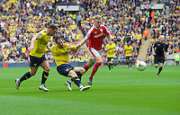Danny Hylton of Oxford United has a shot on goal during the Johnstone's Paint Trophy Final match between Oxford United and Barnsley at Wembley Stadium, London, England on 3 April 2016. Photo by Alan  Stanford / PRiME Media Images.