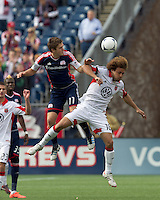 New England Revolution midfielder Kelyn Rowe (11) and DC United midfielder Nick DeLeon (18) battle for head ball. In a Major League Soccer (MLS) match, DC United defeated the New England Revolution, 2-1, at Gillette Stadium on April 14, 2012.