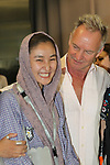 "English singer STING with Afghan refugee girl. The famous singer paricipates in Unveiling Ceremony of the Artwork-tapestry ""I Love Greece"" at Athens airport. In which Amnesty international participated too. The artist is Sophia Vari."