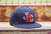A Johnson City Cardinals hat sits on the dugout steps prior to the game against the Elizabethton Twins at Cardinal Park on July 27, 2014 in Johnson City, Tennessee.  The game was suspended in the top of the 5th inning with the Twins leading the Cardinals 7-6.  (Brian Westerholt/Four Seam Images)