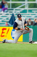 First baseman Dallas McPherson #8 of the Charlotte Knights makes a difficult play for an out against the Pawtucket Red Sox at McCoy Stadium on June 14, 2011 in Pawtucket, Rhode Island.  The Knights defeated the Red Sox 4-2 in 11 innings.    Photo by Brian Westerholt / Four Seam Images