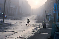Drogheda Fair Street Fog 7.00am. <br /> Messing with me camera in the early morning fog down along the George Street end on Fair Street. caught the shape of someone crossing from Scholes Lane to Bolton Street silhouetted between the fog and backlight. Cartier-Bresson's &quot;decisive moment&quot;? but it escaped me chuh!! I was required to wait half an hour till the situation repeated so's to enable me to take this shot!<br /> The shape of a person crossing from Scholes Lane to Bolton Street silhouetted by the fog and street backlight. <br /> I am aware the view is askew I do not wish to correct it
