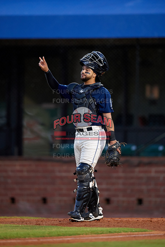 Mobile BayBears catcher Francisco Arcia (32) signals to the defense during a game against the Pensacola Blue Wahoos on April 25, 2017 at Hank Aaron Stadium in Mobile, Alabama.  Mobile defeated Pensacola 3-0.  (Mike Janes/Four Seam Images)