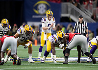 ATLANTA, GA - DECEMBER 7: Joe Burrow #9 of the LSU Tigers calls signals at the line during a game between Georgia Bulldogs and LSU Tigers at Mercedes Benz Stadium on December 7, 2019 in Atlanta, Georgia.