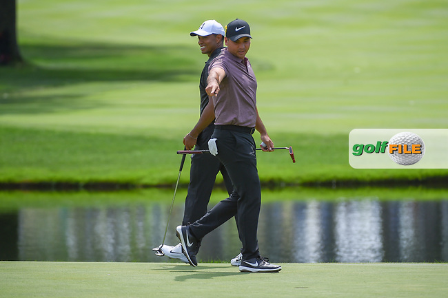Jason Day (AUS) draws a laugh out of Tiger Woods (USA)as he points on the green on 3 during 2nd round of the World Golf Championships - Bridgestone Invitational, at the Firestone Country Club, Akron, Ohio. 8/3/2018.<br /> Picture: Golffile | Ken Murray<br /> <br /> <br /> All photo usage must carry mandatory copyright credit (© Golffile | Ken Murray)