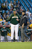 Baylor Bears head coach Steve Smith #34 argues a call with third base umpire Danny Eldridge in game action versus the Rice Owls in the 2009 Houston College Classic at Minute Maid Park March 1, 2009 in Houston, TX.  The Owls defeated the Bears 8-3. (Photo by Brian Westerholt / Four Seam Images)