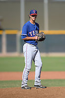 Texas Rangers pitcher Sterling Wynn (84) during an Instructional League game against the Cincinnati Reds on October 3, 2014 at Surprise Stadium Training Complex in Surprise, Arizona.  (Mike Janes/Four Seam Images)