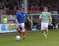 Tom Walsh being chased by Calum Waters in the Celtic v Rangers City of Glasgow Cup Final match played at Firhill Stadium, Glasgow on 29.4.13,  organised by the Glasgow Football Association and sponsored by City Refrigeration Holdings Ltd.