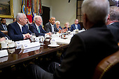 United States President Barack Obama, center, speaks while meeting with current and former diplomatic and national security officials including Colin Powell, former U.S. Secretary of State, from left, James Baker, former U.S. Secretary of State, Obama, Henry Kissinger, former U.S. Secretary of State, Madeleine Albright, former U.S. Secretary of State and founder of Albright Stonebridge Group LLC, and Admiral Mike Mullen, former chairman of the U.S. Joint Chiefs of Staff, to discuss the Trans-Pacific Partnership (TPP) in the Roosevelt Room of the White House in Washington, D.C., U.S., on Friday, November 13, 2015. Obama, hoping to kick off a new phase of selling the TPP at home while enhancing its prospects overseas, has enlisted some of the nation's top national security leaders to give testimonials. <br /> Credit: Andrew Harrer / Pool via CNP