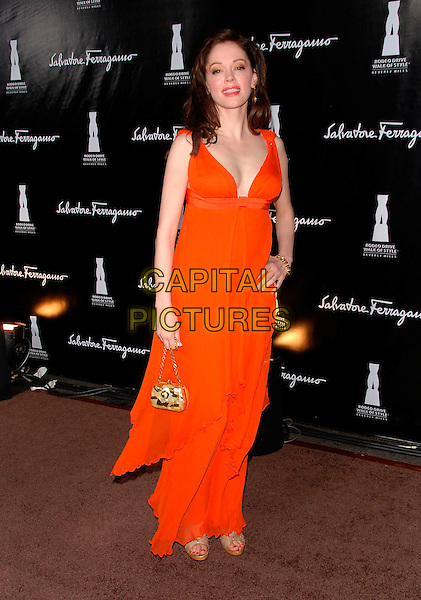 ROSE McGOWAN.Attends The Rodeo Drive Walk of Style,.held on Rodeo Drive in Beverly Hills, .LA, California, USA, October 8th 2006. .full length red orange dress hand on hip.Ref: DVS.www.capitalpictures.com.sales@capitalpictures.com.©Debbie VanStory/Capital Pictures