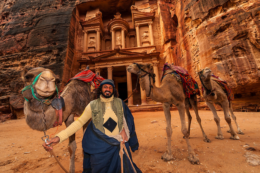 Bedouin Man With His Camels With The Treasury Monument