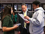 Nevada Assemblyman Mike Sprinkle, D-Sparks, talks with Sparks Middle School students Yazmin Quintero, 13, and Josh Malafu, 14, during Digital Learning Day at the Legislative Building in Carson City, Nev., on Thursday, Feb. 5, 2015. The students, part of a Nevada Ready 21 presentation, show Sprinkle how they complete their algebra lessons on their iPads. <br /> Photo by Cathleen Allison