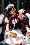 A maid cafe waitress sprinkles water during the ''Uchimizukko Big Gathering Festival'' in Akihabara electric district of Tokyo, Japan on August 23, 2015. About 21 groups from Akihabara including maid cafes' waitresses and cosplayers attended the event, which included for the first time an official mascot character ''2C Chan.'' This year is the 12th anniversary of the event which began as a way to reduce dust and cool pavements in the Akihabara area. Uchimizukko is a Japanese summer tradition. (Photo by Rodrigo Reyes Marin/AFLO)