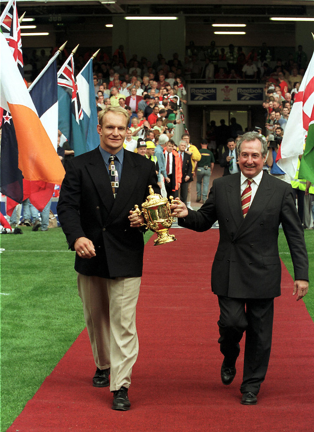 Photo. Richard Lane.WALES V SOUTH AFRICA. 26/6/99..Gareth Edwards and Francois Pienaar display the William Webb Ellis Trophy before the inorgrial match at Wales' new Millennium Stadium which will hold the 1999 Rugby World Cup Final ..