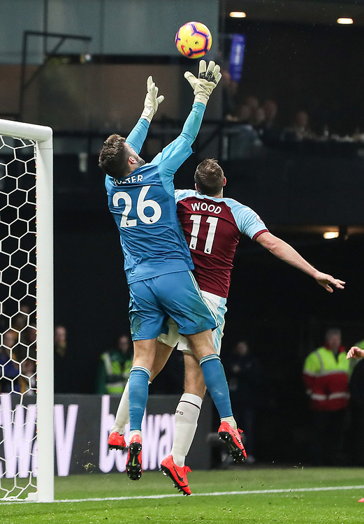 Burnley's Chris Wood competing with Watford's Ben Foster<br /> <br /> Photographer Andrew Kearns/CameraSport<br /> <br /> The Premier League - Watford v Burnley - Saturday 19 January 2019 - Vicarage Road - Watford<br /> <br /> World Copyright &copy; 2019 CameraSport. All rights reserved. 43 Linden Ave. Countesthorpe. Leicester. England. LE8 5PG - Tel: +44 (0) 116 277 4147 - admin@camerasport.com - www.camerasport.com