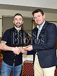 Fergal Diamond receives the St Mary's GAA Club Junior player of the Year award from selector Brian Keenan at their awards night in their clubrooms. Photo:Colin Bell/pressphotos.ie
