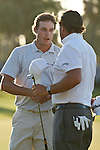 DORAL, FL. - Nick Watney and Phil Mickelson shake hands after final round play at the 2009 World Golf Championships CA Championship at Doral Golf Resort and Spa in Doral, FL. on March 15, 2009