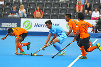 Chinglensana Kangujam of Malaysia is closed down by the Indian defence during the Hockey World League Quarter-Final match between India and Malaysia at the Olympic Park, London, England on 22 June 2017. Photo by Steve McCarthy.