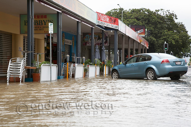 Street in city centre flooded due to torrential rain and king tides.  Cairns, Queensland, Australia