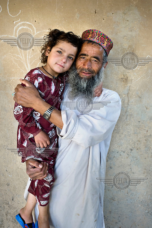 A man holding his daughter.