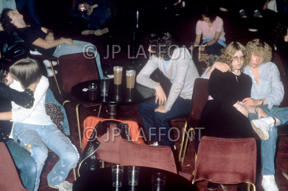 August 1981. Newcastle area, England. During this time the Punk movement begins, and tattoos, piercings, and colorful hair become popularized. At the same time the Romantic movement is born, and makeup, black and white clothing are the typical fashion seen at night clubs and dance parlors. Youngsters drink and party during and after the punk rock concert.