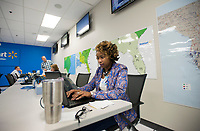 NWA Democrat-Gazette/CHARLIE KAIJO Latoya Haliburton of Bentonville works with suppliers in Tampa, Fla. to ensure Wal-Marts in the hurricane zone are stocked with needed merchandise at the Wal-Mart Home and Office Emergency Operations Center in Bentonville, AR on Friday, September, 8, 2017. Emergency Operations Center (EOC) has been a hub of activity the past couple of weeks because of the Hurricane Harvey and Hurricane Irma.