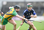 Cathal Darcy of Kilmaley in action against Darren Cullinan of Inagh-Kilnamona during their Minor A county final at Cusack Park. Photograph by John Kelly.