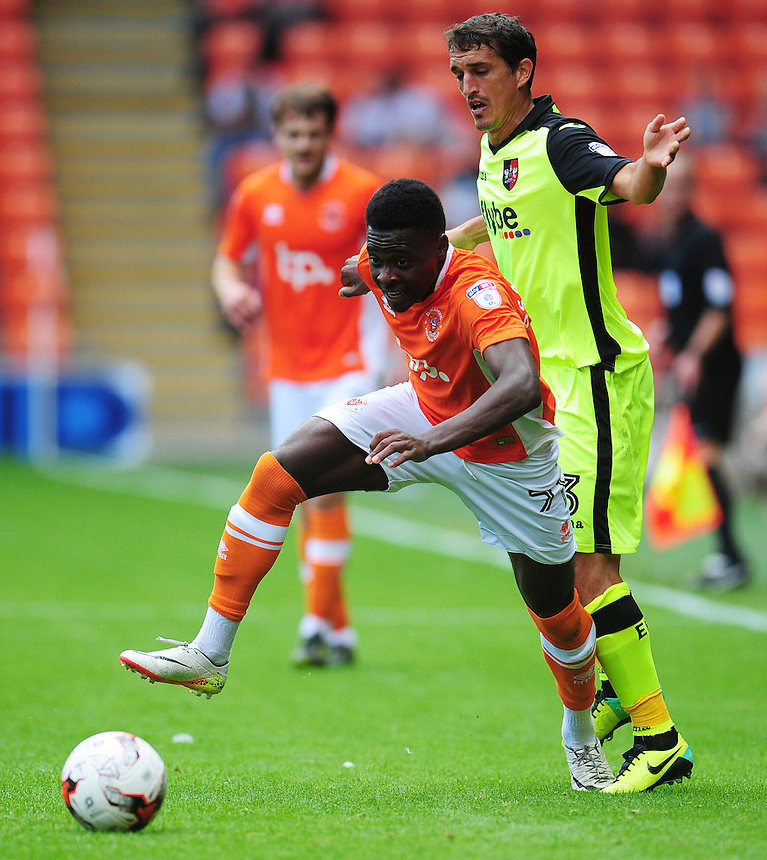 Blackpool's Bright Osayi-Samuel under pressure from Exeter City's Craig Woodman<br /> <br /> Photographer Kevin Barnes/CameraSport<br /> <br /> Football - The EFL Sky Bet League Two - Blackpool v Exeter City - Saturday 6th August 2016 - Bloomfield Road - Blackpool<br /> <br /> World Copyright &copy; 2016 CameraSport. All rights reserved. 43 Linden Ave. Countesthorpe. Leicester. England. LE8 5PG - Tel: +44 (0) 116 277 4147 - admin@camerasport.com - www.camerasport.com