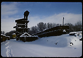 Winter view of Chama coaling tower &amp; sand house. Three drop-bottom gondolas and on the refill track.<br /> D&amp;RGW  Chama, NM