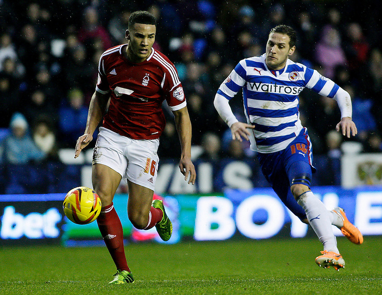 Nottingham Forest's Jamaal Lascelles is closed down by Reading's Billy Sahrp.<br /> <br /> Photo by James Marsh/CameraSport<br /> <br /> Football - The Football League Sky Bet Championship - Reading v Nottingham Forest - Wednesday 1st january 2014 - Madejski stadium - Reading<br /> <br /> &copy; CameraSport - 43 Linden Ave. Countesthorpe. Leicester. England. LE8 5PG - Tel: +44 (0) 116 277 4147 - admin@camerasport.com - www.camerasport.com