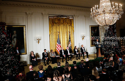 United States President Barack Obama speaks during a ceremony for 2016 Kennedy Center Honorees, in the East Room of the White House, December 4, 2016, Washington, DC. The honorees include (L-R) pianist Martha Argerich, actor Al Pacino, singer Mavis Staples, singer James Taylor and Eagles band members Don Henley, Timothy B. Schmit, Joe Walsh. <br /> Credit: Aude Guerrucci / Pool via CNP