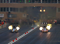 Jul. 18, 2014; Morrison, CO, USA; NHRA top fuel driver Doug Kalitta (right) races alongside Khalid Albalooshi during qualifying for the Mile High Nationals at Bandimere Speedway. Mandatory Credit: Mark J. Rebilas-